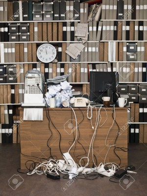 15183818-Overloaded-desk-at-a-messy-office-Stock-Photo